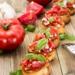 Fresh made Antipasti (Bruschetta) - Stock Photo