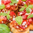 Bruschetta on a plate (macro shot) - Stock Photo