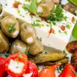 Different types of Antipasto on a plate — Stock Photo