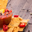 Glass with Salsa Sauce and Nachos — Stock Photo