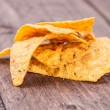 Stock Photo: Nachos on wooden background
