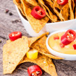 Stock Photo: Portion of Nachos with Cheese Sauce