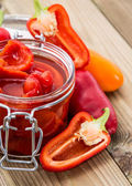 Pickled Paprikas in a glass — Stock Photo