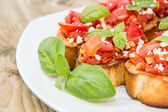 Bruschetta on a plate — Stock Photo
