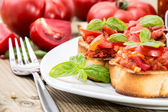 Bruschetta on a plate (macro shot) — Stock Photo