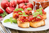 Bruschetta with ingredients — Stock Photo
