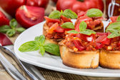 Fresh made Bruschetta on a plate — Stock Photo
