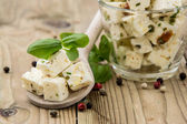 Wooden spoon with Feta and Olives — Stock Photo