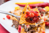 Fresh Nachos on a fork — Stockfoto