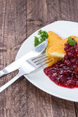 Portion of fried cheese with Cranberries — Stock Photo