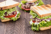 Fresh made Tuna Sandwiches on wood — Stock Photo