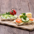 Cutting board with Crispbreads and Herbs — Zdjęcie stockowe