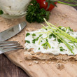 Fresh Cream Cheese on Crispbread — Stock Photo #13248818