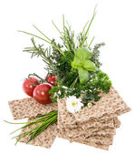 Crispbread with fresh Herbs on white — Stock Photo