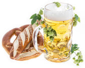 Mug of Beer and Pretzels on white — Stock Photo
