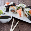 Mixed Sushi on a plate — Stock Photo #13877631