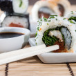 Sushi rolls with sticks and Soy Sauce — Stock Photo
