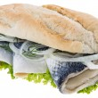 Herring Filet on a baguette (against white) — Stock Photo