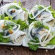 Herring Filet on small plates — Stock Photo #13877705