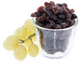 Glass with Raisins isolated on white — Stock Photo