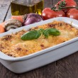 Lasagne in a gratin dish — Stock Photo