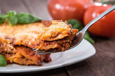 Piece of fresh made Lasagne on a fork — Stock Photo