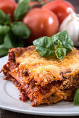 Plate with a piece of fresh made Lasagne — Stock Photo