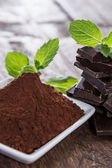 Chocolate with a heap of Cocoa — Stock Photo