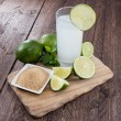 Lime Juice on wood - Stock Photo