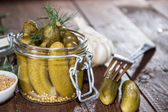 Gherkins in a glass — Stock Photo