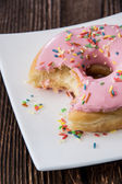 Single Pink Donut on a plate — Stock Photo