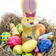 Easter Nest with Candy on white - Stock Photo