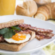 Fried Egg Sandwich with Bacon - Stock Photo