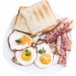 Fried Eggs and Bacon isolated on white - Stock Photo