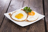 Fried Eggs on a plate — Stock Photo