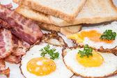 Fried Eggs and Bacon on a plate — Stock Photo