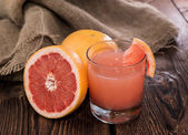 Portion of Grapefruit Juice — Stock Photo