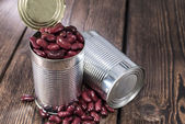Can with Kidney Beans on wood — Zdjęcie stockowe