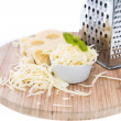 Emmentaler with Cheese Grater on white — Stock Photo