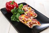 Portion of Salami Pizza Baguette — Stock Photo