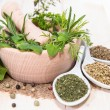 Stock Photo: Fresh herbs in a small wooden bowl