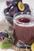 Glass with fresh Plum Juice — Stock Photo