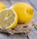 Lemons on vintage wooden background — Stock Photo
