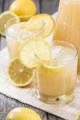 Glass with Lemon Juice — Stock Photo
