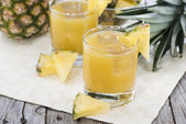 Portion of fresh Pineapple Juice — Stock Photo