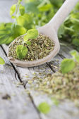 Wooden Spoon with shredded Oregano — Stock Photo