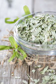 Dried Tarragon in a small bowl — Stock Photo