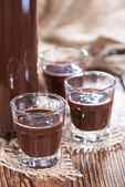 Glass with Chocolate Liqueur — Stock Photo
