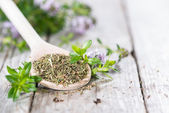 Dried Winter Savory on a cooking spoon — Stock Photo