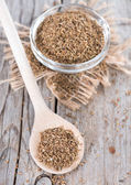 Dried Aniseed on a wooden spoon — Stock Photo